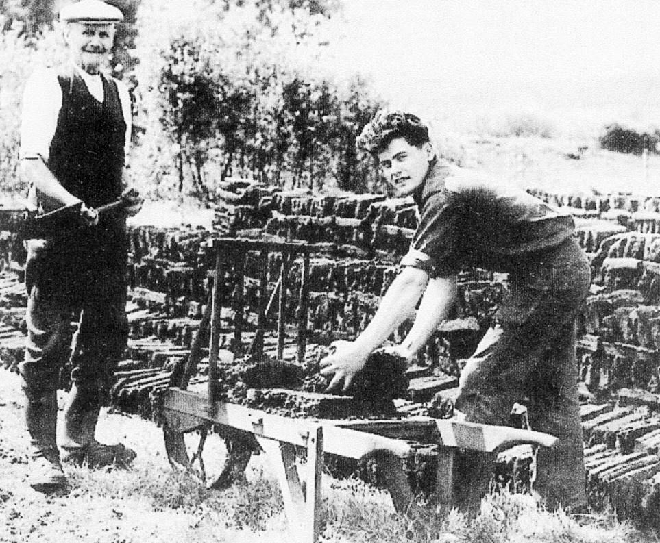 Joe Park and John Myers loading a peat barrow
