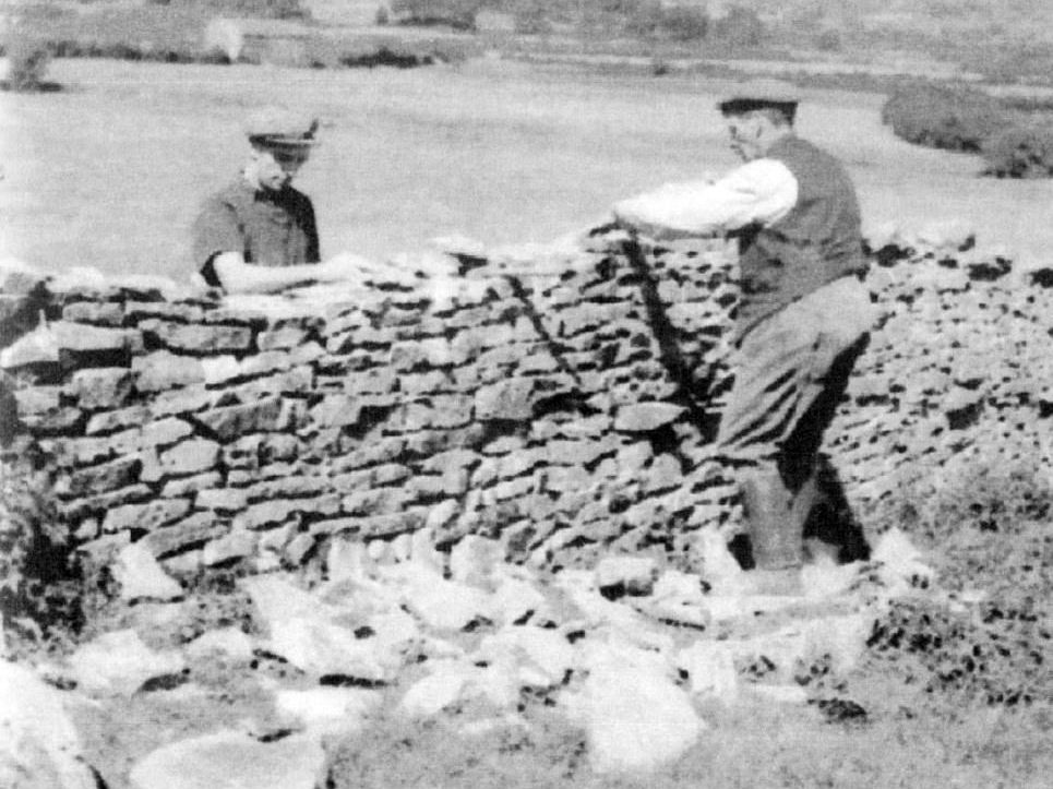 Alan Jackson and his father dry-stone walling at Row Farm