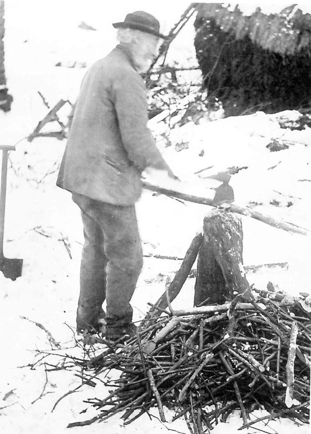 Grandad John Gardner chopping sticks for kindling