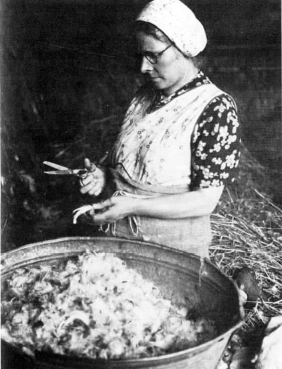 Sally Inman making a feather bed<br/><small>(National Trust)</small>
