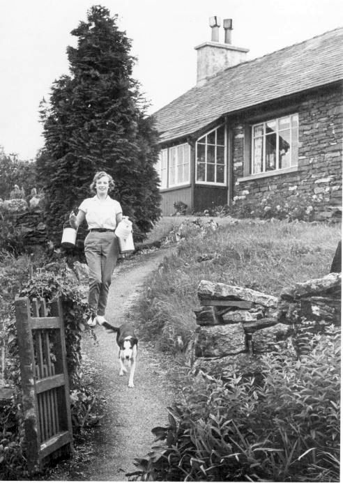 Joan Walling delivering milk to the bungalow at Strickland Tenement