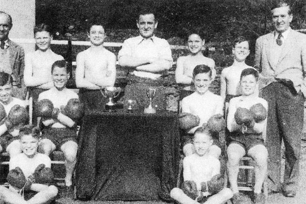 Kit Newton and boys with boxing trophies